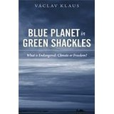 Blue planet in green shackles